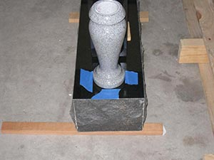 Marking the vase's position with tape